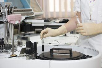 photo of laboratory and scientist creating biosimilar patents