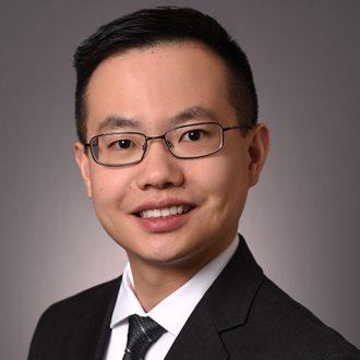 Headshot Photo of Dallas Patent Attorney Young Fei