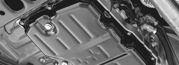 Oil Pan Fastened to a Car Using Patented Automotive Technology